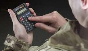 Service personnel tapping on a calculator