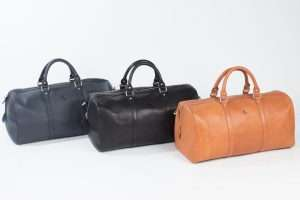 Image of three travel bags in different colours