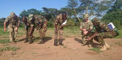 The STTT introduce KDF students to ground signs.