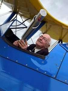 "light Lieutenant Russell ""Rusty"" Waughman flies a Boeing Steerman with the RAF100 Baton on-board."