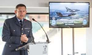 Talking about the investment at Marham, Wing Commander Stew Geary at Norfolk Armed Forces Covenant Conference at Carrow Road. Photo : Steve Adams