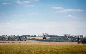 This is an image showing Royal Air Force Puma 2 helicopters based at RAF Benson and Chinooks from Benson and RAF Odiham departing from Benson for the RAF centenary fly past in London