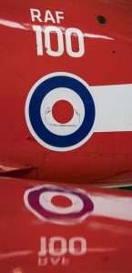 Reflection of the RAF 100 badge in the Red Arrows wing