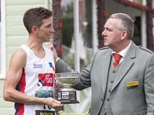Cpl James Bellward receiving the Gathering Hill Race trophy