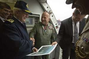 Inspector General of the Morrocan Forces Royales Air Brigadier General El Abed Alaoui Bouhamid is presented with commemorative print aboard Voyager.