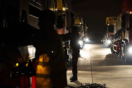 A driver from RAF Wittering makes final checks to secure the load