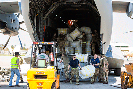 Image of an RAF A400M Atlas aircraft, seen here at Beira International Airport in Mozambique, where RAF personnel and charity workers worked together to offload the aircraft quickly and effectively.