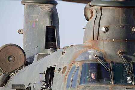 Sqn Ldr Matthew Wight-Boycott at the controls of a RAF CH 47 Chinook