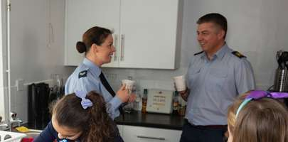 Image of a serving couple drinking coffee in a kitchen