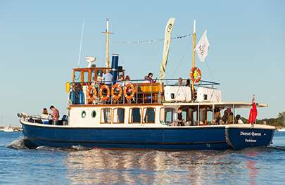 Image of the Dorset Queen on the water with guests on board