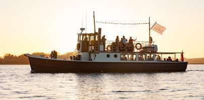 Image of the Dorset Queen on the water in a sunset scene