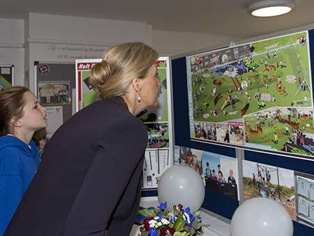 Image HRH looks at the designs for the play park.