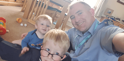 Image of FS Jon Burt-Matthews with children