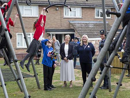 Image shows one of the children from Wittering Primary School tests out the new monkey bars.