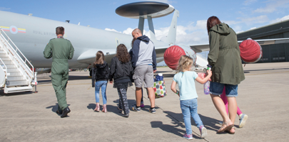 Photo shows family crossing to aircraft supporting image for Removing Barriers to Family Life programme