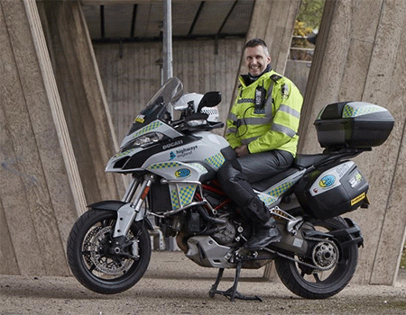 Image shows Sgt Rob Gilligan of Central Motorway Police Group on a BikeSafe Ducati