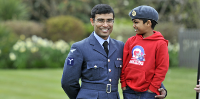 Image shows SAC Balamurugan Jayaraju with his son