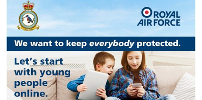 Image shows children reading on mobile and tablet illustrating keeping young people safe online