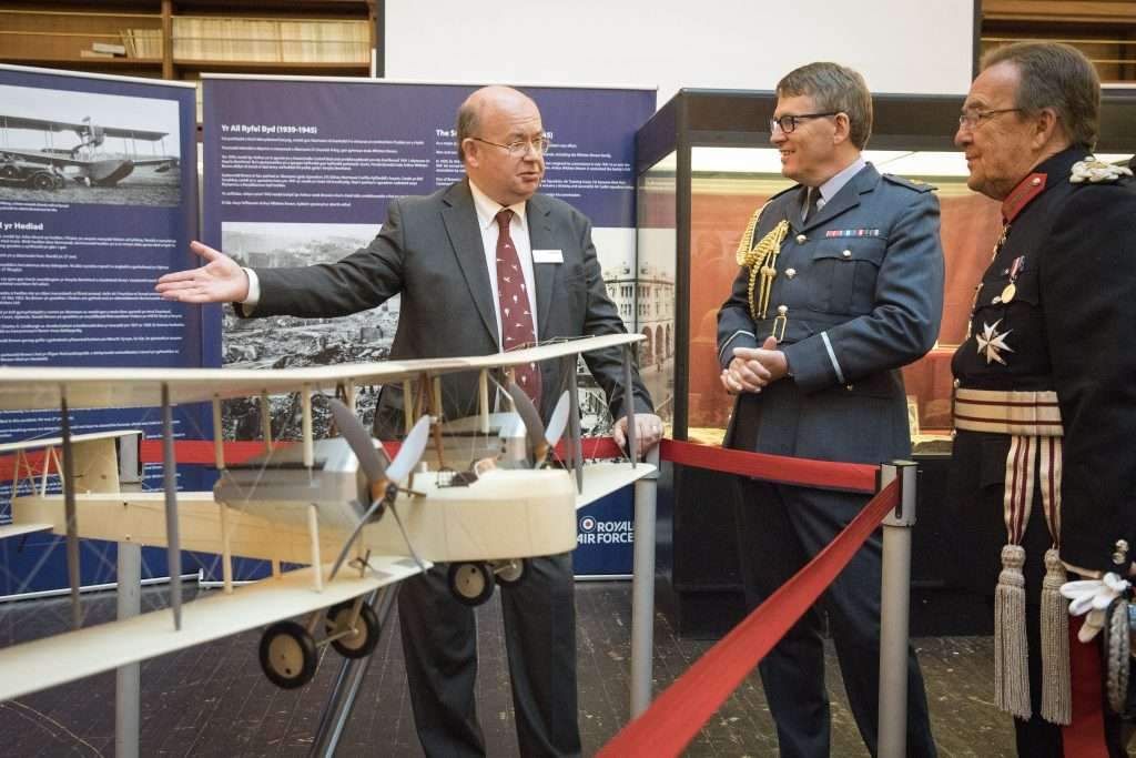 Pictured left to right: Howard Mason of BAE Systems, Air Commodore Adrian Williams Air Officer Wales, Lord Lieutenant D. Byron Lewis looking at the model Vickers Vimy at the Alcock and Brown Centenary Exhibition in Swansea Museum