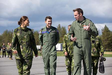 Image: Visit by Victoria, HRH the Crown Princess of Sweden, Duchess of Vastergotland pictured with Wing Commander Matthew D'Aubyn (centre) and another pilot from the Royal Air Force.
