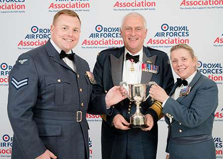 Flight Sergeant Michelle Rees-Martin and Corporal Ash Oldroyd-Clarke accept the Lord Tedder trophy from Air Marshal Sir Baz North, President of the RAF Association.