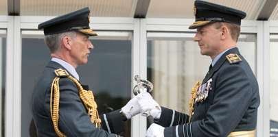 Image of Air Chief Marshal Sir Stephen Hiller handiing over the sword to the new CAS, Air Chief Marshal Mike Wigston.