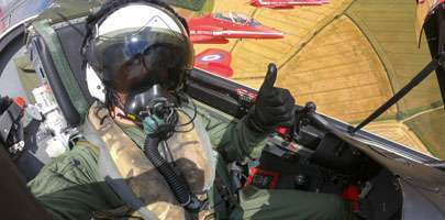 Tim Peake receives a flight in a Red Arrow Hawk T1 during an In Season Practice at RIAT