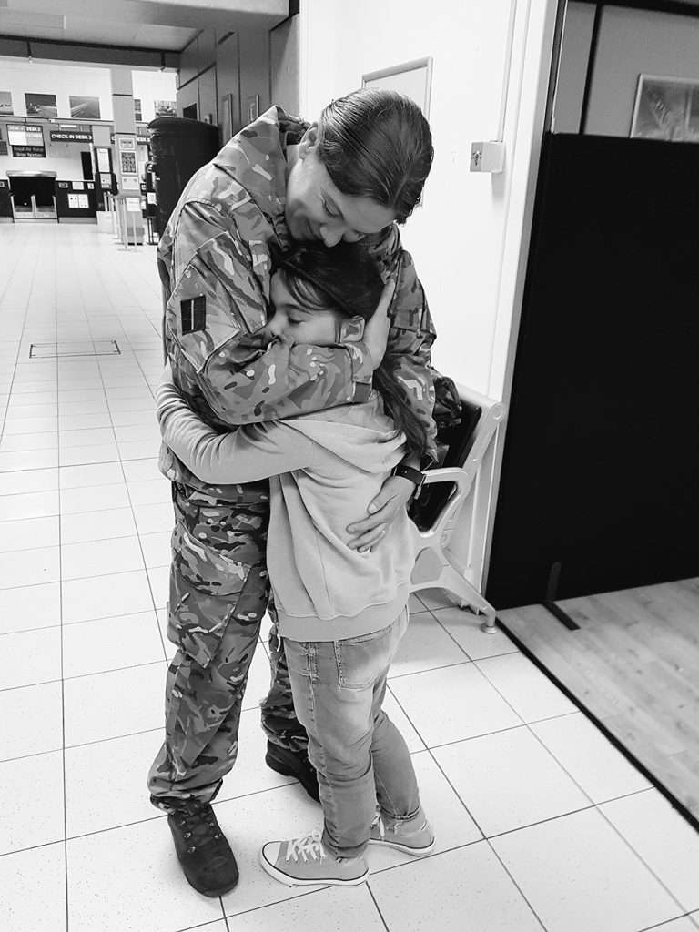 An image of a daughter and her mum being reunited after a deployment/exercise.