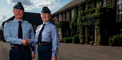From left to right: Group Captain Tony Keeling hands over to Group Captain Jo Lincoln - Image By: SAC Kim Waterson