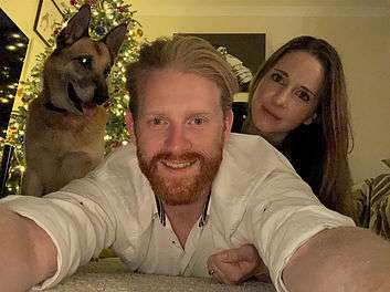Image of Chris, his wife and family German Shepherd.