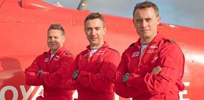 Image of the three new Red Arrows for 2020 stood in front of an aircraft