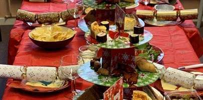 A typical picture of a Christmas lunch laid out on a table.