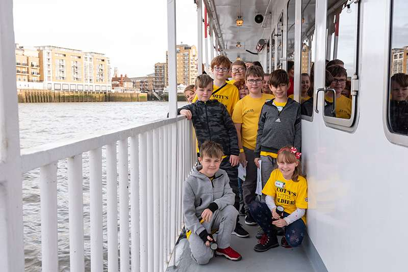 Some of the children aboard the Dixie Queen boat stood outside.