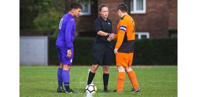 Corporal Lauren Impey refereeing a football match at RAF Wittering.