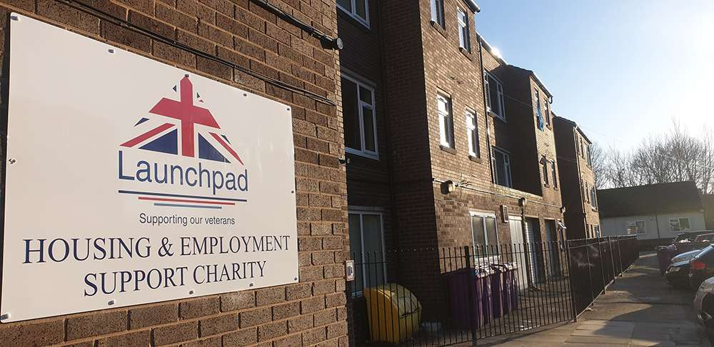 Launchpad building with their logo on the side of the accommodation block.