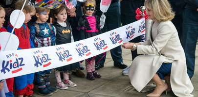 Local children mark the official opening of RAFA Kidz Cranwell, with Kate Wigston, wife of the Chief of the Air Staff