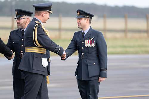 Air Chief Marshal Mike Wigston, Chief of the Air Staff shaking hands with Officer Commanding CXX Squadron Wing Commander James Hanson.