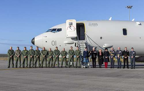 The Poseidon crew and VIPs stand in front of the new RAF P-8A Poseidon.