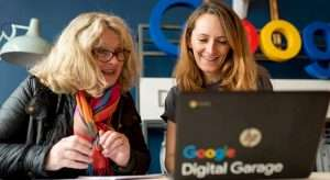 Image from Google's digital garage showing two ladies sat at a laptop with Google Digital Garage's colourful branding on the laptop cover.