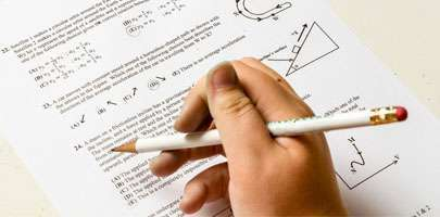 Image of hand with exam paper illustrating maintaining educational provision - key workers