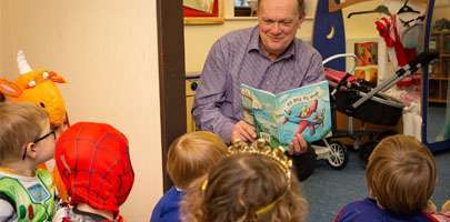 Richard Bland, author of AB Gets His Wings, with children at RAFA Kidz Odiham.