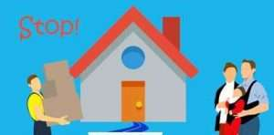 Cartoon image of a family moving into a house