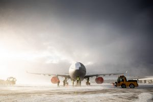 RAF Voyager aircraft sit in the snow at Mount Pleasant Complex, Falkland Islands while personnel work to ensure the snow is cleared.