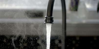 Image of a sink tap running continuously