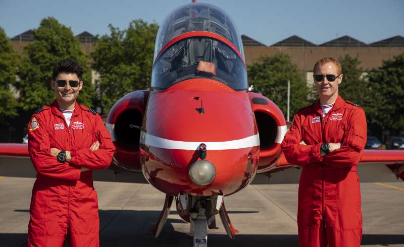 Pictured here are Wing Commander David Montenegro, Red 11 and Squadron Leader Martin Pert, Red 1, next to a Hawk T1 at Raf Scampton
