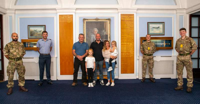 Darren Ruck with his family (centre) during his visit to RAF Honington to meet the personnel that potentially saved his life on 21st June 2020.