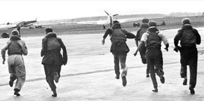 Image of Air crew running towards their aircraft in WWII