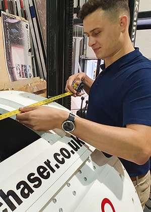 SAC(T) Luke Marston at work on the Nova 2 rocket capsule.
