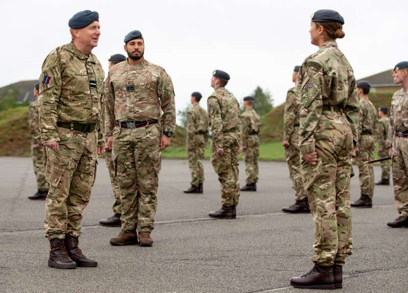 Air Commodore Simon Harper OBE MA RAF (left) reviewing the graduation parade at RAF Honington.